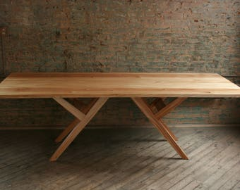 Reclaimed Wood Dining Table, modern, with natural finishes.