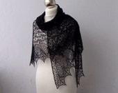 Black hand knitted cobweb lace shawl