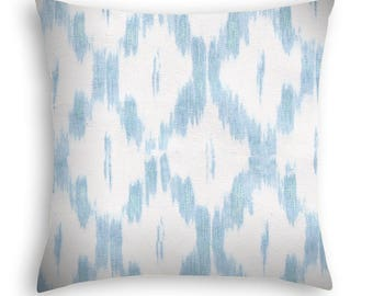 Sky blue and white contemporary Ikat throw pillow by Laura + Kiran, made in India.