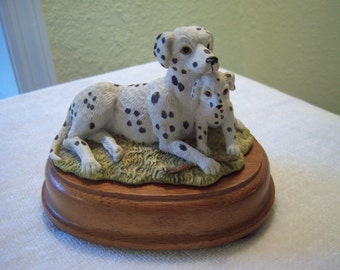 dalmatian sculpture,resin sculpture,dalmatian with puppy,oak base,black and white,1993,Summit Collection,dog collectible,dog lovers
