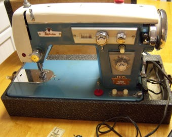 vintage sewing machine,Super Deluxe,Ferguson,made in Japan,motor made in Tokyo,blue and cream color,chrome accents,carry case,retro sewing