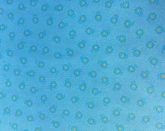 Lecien Flower Sugar fabric Turquoise flower with yellow center.