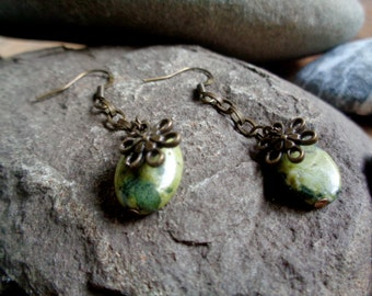 Antique bronze, hypoallergenic earrings with green stone beads and golden chain and flower charms