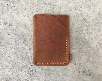 Trifold wallet in avancorpo pull-up leather with green thread