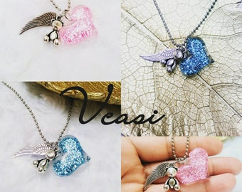 In memory and loved one necklace. Heart, wing and teddy bear necklace