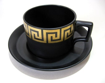 Portmeirion Greek Key teacup and saucer in matt black and gold; 1960s retro designer Susan Williams Ellis
