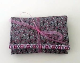 Travel sewing kit in pink and grey.