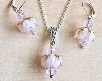Pale pink flowers set in 925 sterling silver, lampwork glass flowers and crystal beads