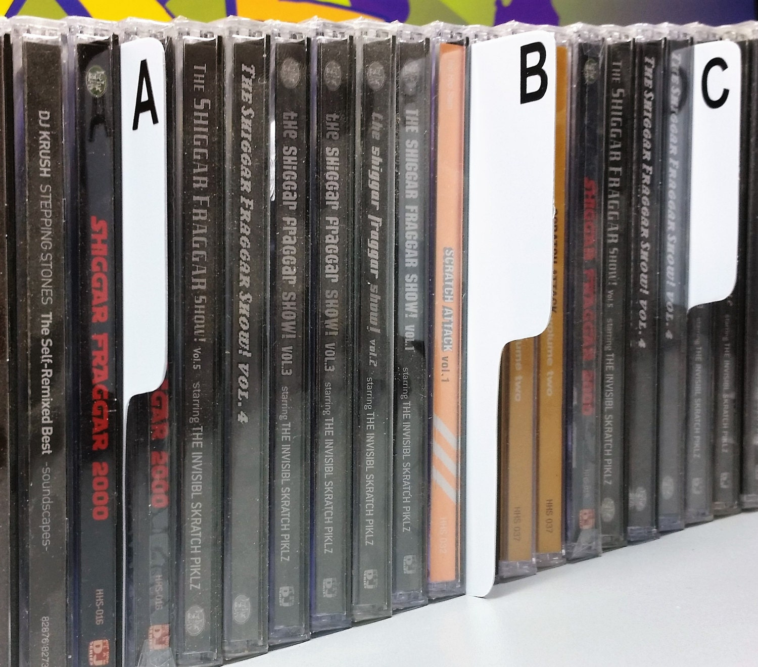 a z shelf dividers for cd spine to side narrow
