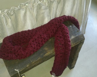 Hand crocheted wine colored scarf.