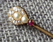 This is a stunning antique 18ct gold and brilliant sparkling diamonds ruby and pearl stick pin