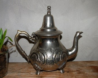 Old silver coloured tea pot