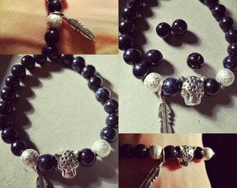 Gemstone bracelet with jaguar and feather charms. Lovely present for Christmas.