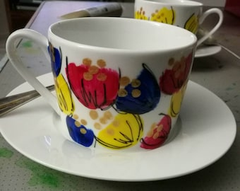 Bespoke multicolored hand painted tea cup and saucer