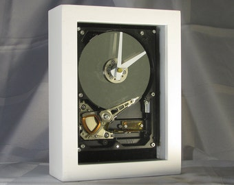 Engineer, Techie or Nerd gift or anyone who loves tech stuff. Display/Desktop/Mantel/Wall/Steampunk clock made from a computer hard drive.