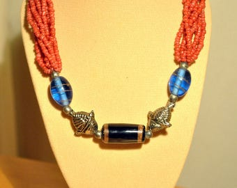 Handmade necklace with acrylic, metallic and glass deads!