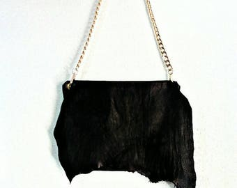 Black cow leather raw edge bag