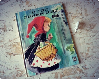 Child of Charles Perrault's story book for children