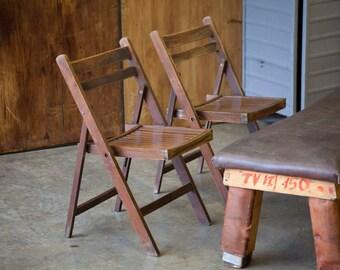Pair of dark wood, vintage, folding chairs