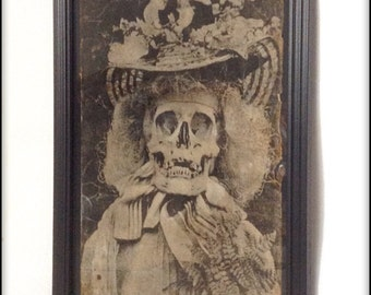 Creepy Victorian skull photograph aged reproduction in frame.