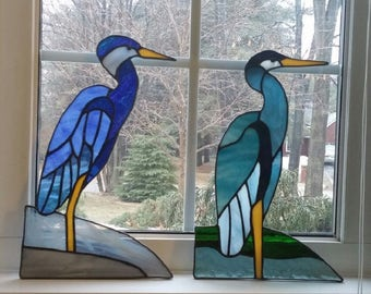 Stained glass bird.Glass ornament.Great blue heron.Glass window panel.Blue glass leaner.Blue suncatcher.Wading bird or standing on rock