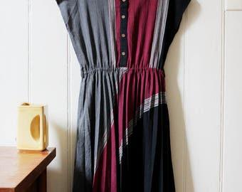Vintage 1980's grey, purple black dark pleated dress featuring wooden buttons - Medium