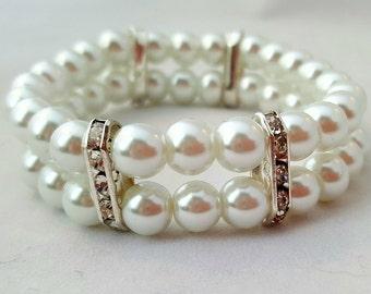 Wedding style bracelet. White glass beads and Rhinestones spacers. Stretch bracelet. White bracelet. Cuff bridal bracelet. Prom bracelet.