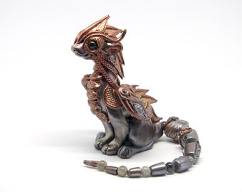 Steampunk silver and copper dragon figurine with posable tail