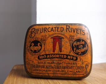 Old vintage tin Bifurcated rivets london