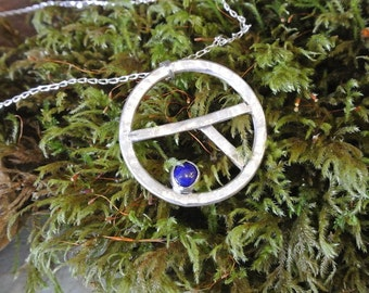 contemporary sterling silver pendant with a papis lazuli cabochon
