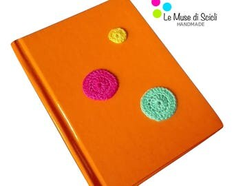 Orange notebook with coloured dot crochet decoration