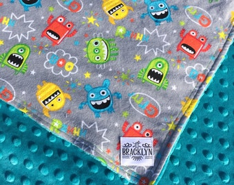 Gray Flannel Tossed Monsters  Baby Blanket with Turquoise Minky