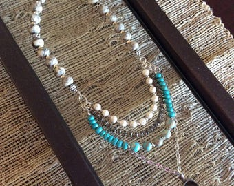 Multilayered bead and chain necklace