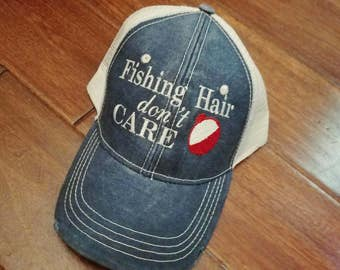 Fishing hair don't care distressed trucker hat with fishing bobber.