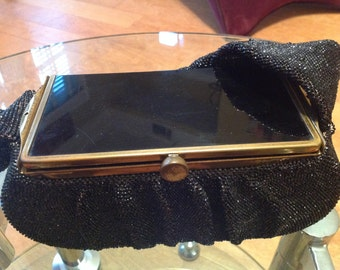 Vintage black steel beaded purse with lucite & brass top