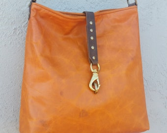 Burnt Orange Leather Bucket-style Shoulder Bag with Vintage European Red-stripe Linen Lining, and Repurposed Bridle Leather Strap