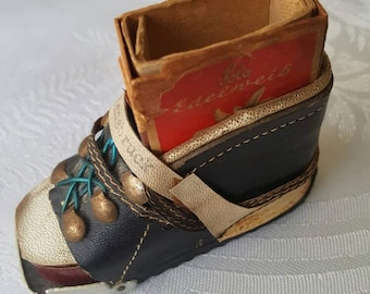 A shoe vesta case with old matchbox in