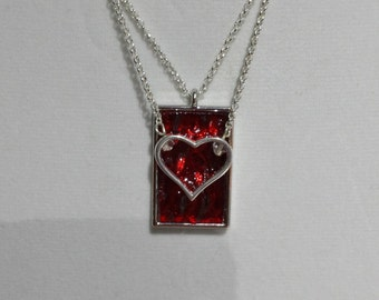 Ruby red stained glass pendant with hanging heart charm