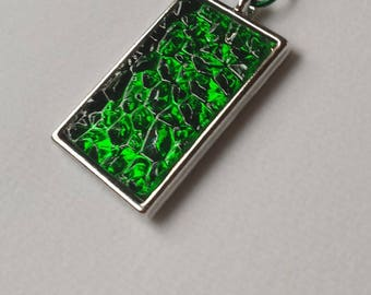 Green stained glass pendant in a metal bezel