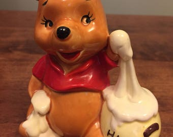 Disney's Winnie the Pooh with his hunny pot