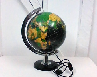 Globe Earth light black vintage world map.