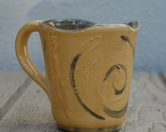 Yellow and Brown Pottery Mug