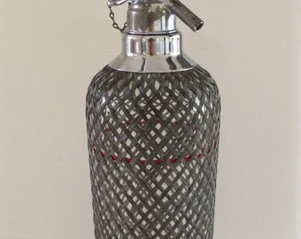 Vintage sparklet soda syphon with with wire mesh