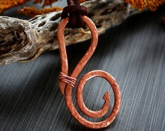 Hand hammered copper pendant.