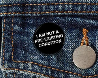 "I Am Not A Pre-Existing Condition Stencil 1"" pinback button"