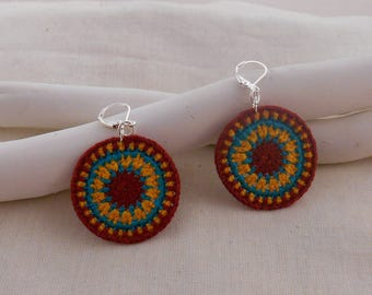 Dark red hypnosis model crochet earrings, turquoise and yellow