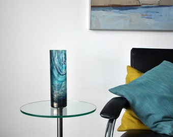 glass vase with multiple layers in various blue colors