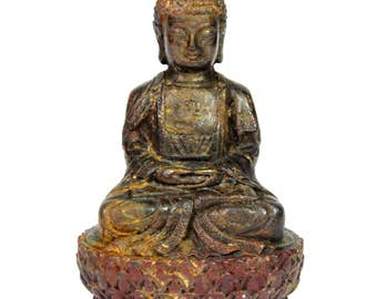 A 19th / early 20th Chinese cast iron figure of the seated Buddha with remnants of colour, H. 10cm.