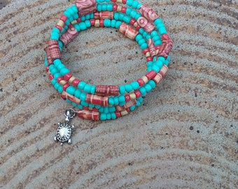 Turquoise and red coral cuff bracelet