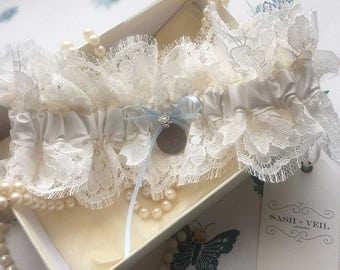 Thea lace wedding garter with genuine silver sixpence charm